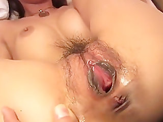 Japanese babe insert a toy into her pussy