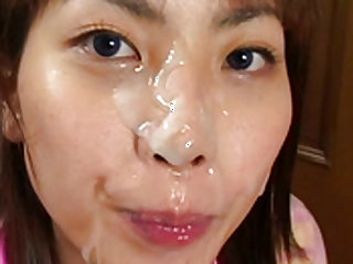 Busty  gets warm jizz on her face